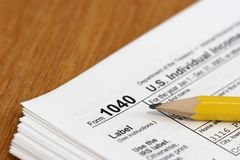 Income Tax. Close view of a pencil and a US tax form 1040 Stock Photography