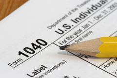 Income Tax. Close view of a pencil and a US tax form 1040 Stock Photos