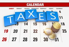 Income tax. As a concept in the background calendar Stock Photo