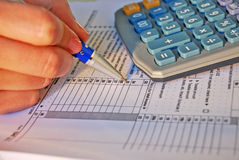 Income tax calculation. Woman calculated income tax. Income tax. Form, hand, pen, calculator Royalty Free Stock Photography