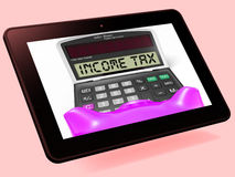 Income Tax Calculator Tablet Means Taxable Earnings And Paying T Stock Image