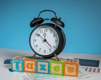Income tax deadline approaching with alarm clock Royalty Free Stock Photos
