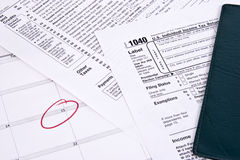 Income tax due. Income tax return, checkbook  and calendar showing due date Stock Images