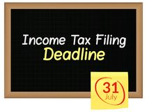 Income Tax Filing Deadline - 31st July - written on Blackboard. Illustration as eps 10 File Stock Photography