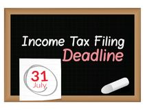 Income Tax Filing Deadline - 31st July - written on Blackboard. Illustration as eps 10 File Royalty Free Stock Images
