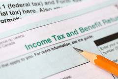 Income tax form. And pen Royalty Free Stock Images