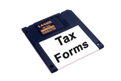 Income Tax forms on floppy disk Royalty Free Stock Images