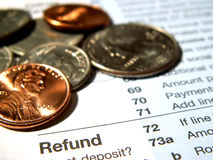 Income tax refund. Coins and an income tax form royalty free stock photo