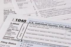 Income Tax Return. U.S. Income Tax Return with focus around 1040 Individual Income Tax Return Stock Photos