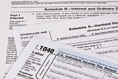 Income Tax Return. U.S. Income Tax return with schedules A and B Royalty Free Stock Photos