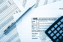 Income tax return with pen and calculator Stock Images