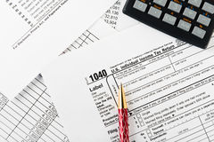 Income tax return with pen and calculator Royalty Free Stock Photo