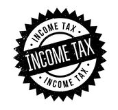Income Tax rubber stamp. Grunge design with dust scratches. Effects can be easily removed for a clean, crisp look. Color is easily changed Stock Photos