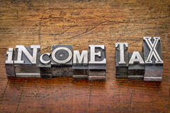 Income tax text in metal type Royalty Free Stock Photo