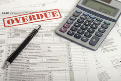 Income Taxes. Close up U.S. taxes papers Royalty Free Stock Photo