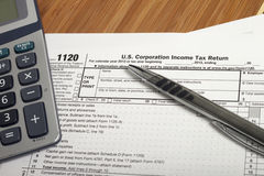 Income Taxes. Close up U.S. taxes papers royalty free stock images