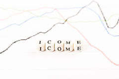 INCOME word written with wooden cubes Royalty Free Stock Image