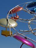 Incoming. Multi color chairs and apparatus of carnival ride royalty free stock photo