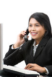 Incoming call. An executive receiving call in her office Royalty Free Stock Photography