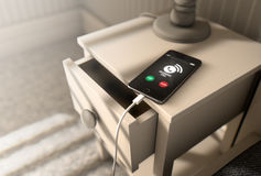 Incoming Call Cellphone Next To Bed Royalty Free Stock Photography