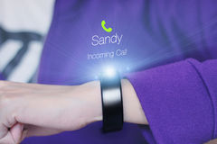 Incoming call icon on smart wristband. A smart wristband is a wearable computing device that closely resembles a wrist watch or other time-keeping device royalty free stock photography