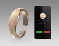 Incoming call information on smart phone and smart band. Stock Photos