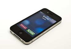 Incoming call on iPhone. An Apple iPhone 4 showing on screen the alert of an incoming call royalty free stock photos