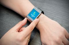 Incoming call notification on smart watch Stock Image