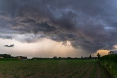 Dramatic sky as threatening storm clouds are moving fast over the landscape of Flanders, Belgium stock images