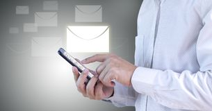 Incoming and outgoing email checking on mobile device. Businessman holding smartphone checking incoming and outgoing email on mobile device. on white-black stock photo