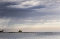 Incoming Rain. Rain clouds sweep across the sky off the shore of Stamford, CT Royalty Free Stock Images