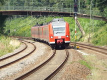 Incoming regional train. Germany, 2014,nA regional train approaches a small holding station Stock Photos