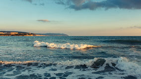 The incoming sea wave against the background of Tolstoy cape coast of Gelendzhik. North Caucasus, Russia Stock Images