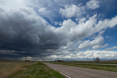 Incoming Thunderstorm. Spring Thunderstorm in eastern Colorado moves in over a rural highway Royalty Free Stock Images