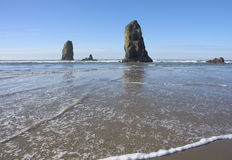 Incoming tide. Rock formations just off the beach with incoming tide at cannon beach, oregon royalty free stock photo