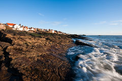 Incoming tide at the coast in Anstruther, Scotland Royalty Free Stock Photos