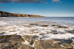 Incoming tide at Cullernose Point Royalty Free Stock Image