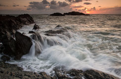 Incoming tide. A view of the lighthouse  at llanddwyn on Angleseyas the tide comes in Stock Images