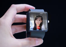 Incoming video call icon on smartwatch screen. Stock Images