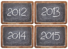 Incoming years on blackboard. Current and incoming years, 2012, 2013, 2014, 2015 on vintage slate  blackboards, isolated on white Stock Image
