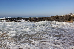 Incomng White Water Wave on Rocky Beach Stock Photography