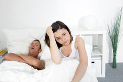 Incompatibility in bed. With a husbands loud snores preventing his wife from getting any sleep and rest Stock Photo