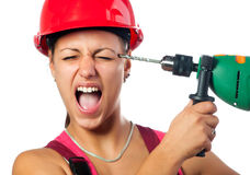 Incompetent Female Worker With Drill Royalty Free Stock Images