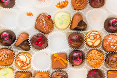 Incomplete box of delicious handmade chocolates Stock Photography
