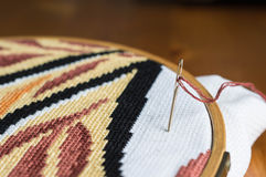 Incomplete embroidery and embroidery needle Royalty Free Stock Photos