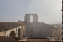 Incomplete facade of the planned Duomo nuovo or Facciatone in fog. Siena. Tuscany Italy. Stock Photos