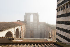 Incomplete facade of the planned Duomo nuovo or Facciatone in fog. Siena. Tuscany Italy. Stock Photo