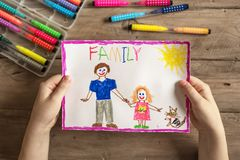 Incomplete family drawing. Children`s drawing of family single dad and daughter. Incomplete family concept stock photos