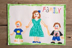 Incomplete family drawing. Children`s drawing of family single mom and two sons. Incomplete family concept stock photos