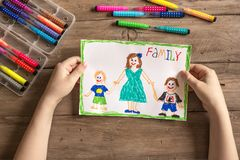 Incomplete family drawing. Children`s drawing of family single mom and two sons. Incomplete family concept stock images